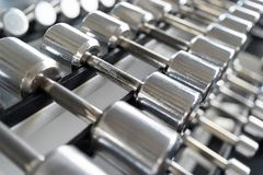 Rows of dumbbells in the gym Stock Photography