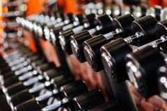 Rows of dumbbells in the gym with hign contrast. In the gym stock images