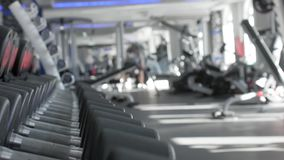 Rows of dumbbells in the gym. The background is out of focus. The background is blurred stock video