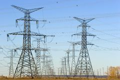 Rows of electrical towers. Wide angle image of rows of electrical towers Royalty Free Stock Images