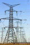 Rows of electrical towers. Wide angle image of electrical towers Royalty Free Stock Image