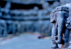 Elephant Statue forming the basement of temple - Hoysala Architecture stock photography