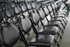 Rows of empty black folding chairs. At an event Royalty Free Stock Photo