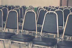 Rows of Empty Black Leather Chairs in a Meeting Room. Rows of Empty Black Leather Chairs in a Meeting Room, Indoor Modern Meeting Room Royalty Free Stock Photos