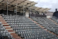 Rows of empty black plastic seats Stock Images