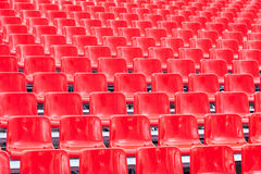 Rows empty bright red plastic seats Royalty Free Stock Photography