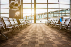 Rows of empty chairs at airport Stock Image