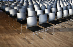 Rows of empty chairs prepared for an indoor event Royalty Free Stock Image