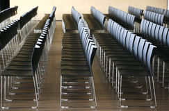 Rows of empty chairs prepared for an indoor event Stock Image