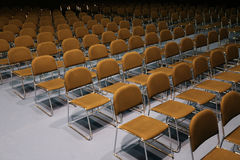Rows of empty chairs prepared for an indoor event Stock Photo