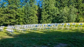 Rows of empty chairs prepared for a wedding ceremony royalty free stock images