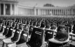 Rows of empty chairs in St.Peter`s square royalty free stock photo
