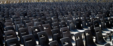 Rows of Empty Chairs. Rows and rows of empty chairs for upcoming event under the hot sunshine Royalty Free Stock Photography