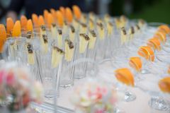 Rows of empty glasses prepared for reception Stock Image