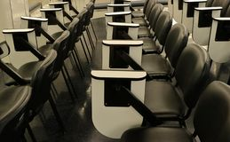 Rows of empty lecture chairs stock photo