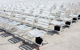 Rows of empty metal chair seats installed for some business event or performance. Festival royalty free stock photo