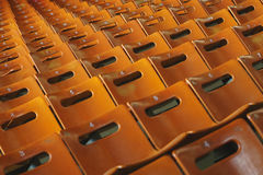 Rows of empty orange seats in the stadium. Places for the spectators. Stock Image