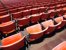 Rows of empty orange stadium seats Royalty Free Stock Photography