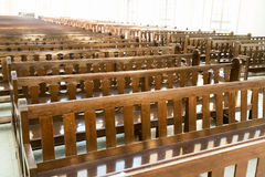 Rows of empty pew benches inside chapel church Royalty Free Stock Photography