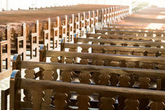 Rows of empty pew benches inside chapel church Stock Image