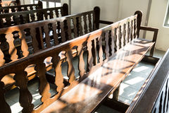 Rows of empty pew benches inside chapel church. Rows of empty pew benches in chapel church Stock Photography