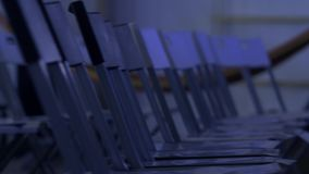 Rows of empty plastic chairs. Ready for business conference audience stock footage