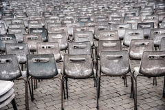 Rows of empty plastic seats, outdoor setting Royalty Free Stock Photography