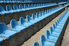 Rows of empty plastic  seats in a stadium Royalty Free Stock Photos