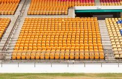 Rows of empty plastic stadium seats Stock Photo