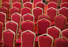 Rows of empty red seats in theater hall. Rows of empty red seats in theater or cinema hall Stock Photography