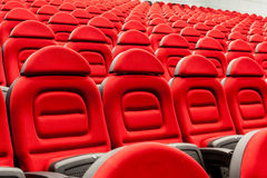 Rows of empty red seats. Rows of empty red velvet seats inside a theater Royalty Free Stock Images