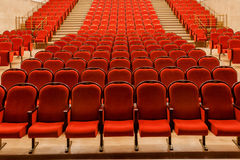Rows of empty red seats. Rows of empty red velvet seats inside a theater Royalty Free Stock Image