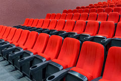 Rows of empty red velvet seats Stock Images