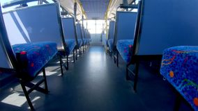 Empty seats in a bus 4k. Rows of empty seats in a bus 4k stock footage