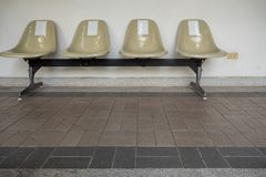 Rows of an empty seats on indoor walkway royalty free stock photography