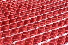 Rows of empty seats in an outdoor theat. Rows of empty bright red seats in an outdoor theater Royalty Free Stock Photography