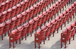 Rows of empty seats in an outdoor theater. Rows of empty red seats in an outdoor theater Stock Photo
