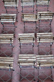Rows of empty slatted wooden seats Stock Images