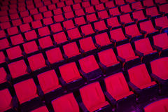 Rows of empty theater seats Stock Photo