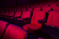 Rows of empty theater seats. Empty rows of red theater or movie seats Royalty Free Stock Image