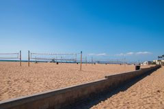 Rows of empty volley ball courts on the sand at the beach. Huntington Beach, California - October 11, 2018: Rows of empty volley ball courts on the sand at the royalty free stock images