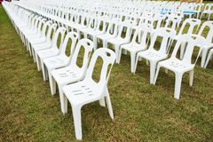 Rows of empty white chairs Royalty Free Stock Images