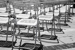Rows of empty white metal chairs Royalty Free Stock Image