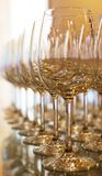 Rows of empty wine glasses. Royalty Free Stock Photography