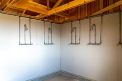 Rows of exposed showers in the bathrooms at the Manzanar Japanese Internment Camp in Independence California. Shows no personal privacy stock photos