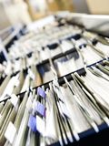 Rows of files. Multiple rows of filing cabinets in an office or medical establishment, overflowing with files.  Narrow depth of field to emphasize the Royalty Free Stock Images