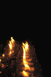 Rows of firing candles Stock Photography