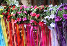 Rows of flower-covered girls headbands with colorful flowing ribbon streamers. royalty free stock photography