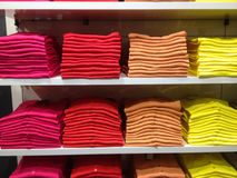 Rows of folded clothes. Rows of folded colorful clothes royalty free stock images