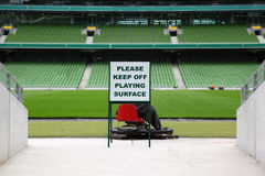 Rows of folded, green seats in empty stadium Royalty Free Stock Images
